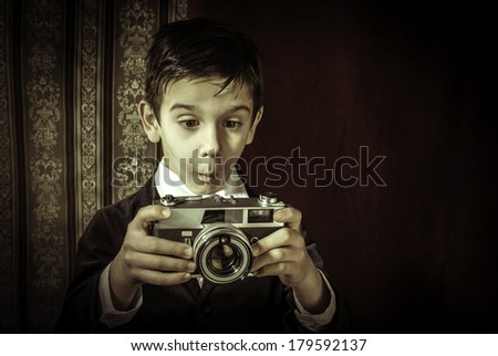 Boy with vintage camera. Vintage clothes - stock photo