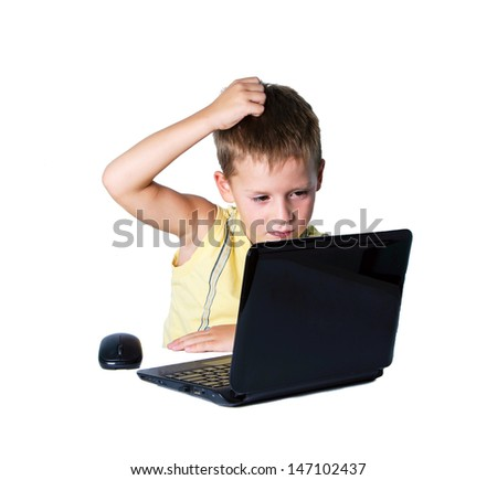 Boy working on a laptop on white background - stock photo