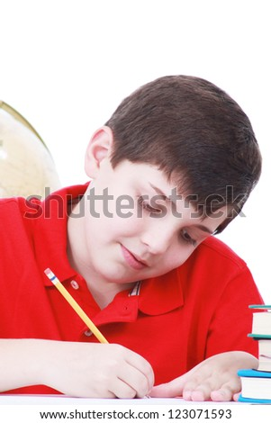Boy writing in a notebook - stock photo