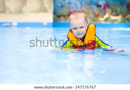boy 4 years swimming in the pool - stock photo