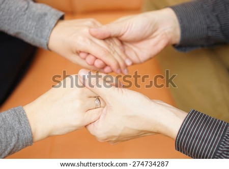 boyfriend hands holding girlfriend hands. Emotions and support concept - stock photo