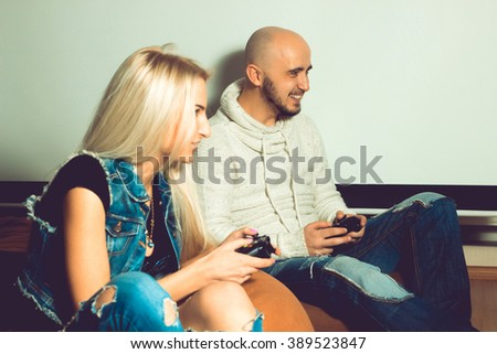Boyfriend having fun and playing computer games with his girlfriend. concept of leisure entertainment and fun - stock photo