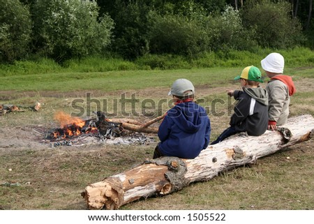 Boys and fire flame - stock photo