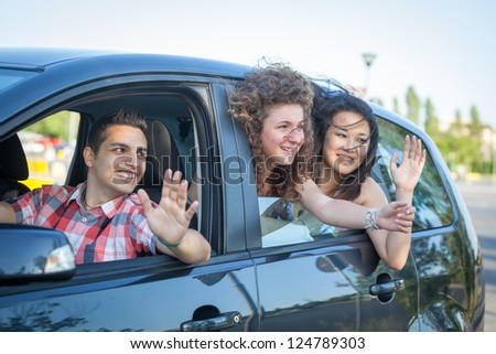 Boys and Girls in a Car Leaving for Vacation - stock photo