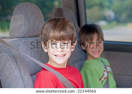 Boys Buckled up in Automobile - stock photo