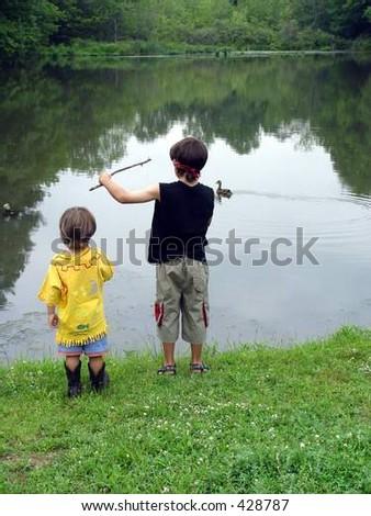 boys by lake - stock photo