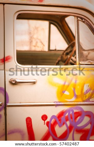 boys funny old car painted with the paint cans - stock photo
