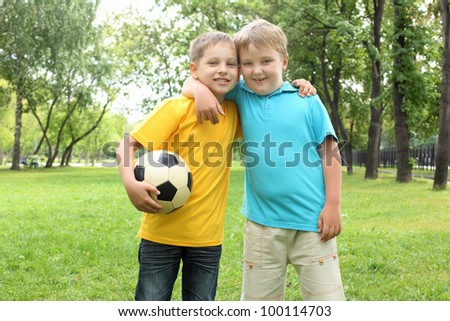 Boys in the summer park with a football ball - stock photo