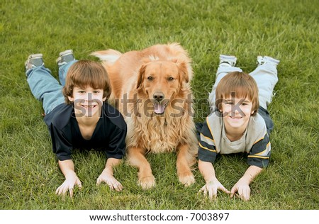 Boys Laying down With Golden Retriever - stock photo