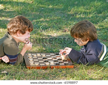 Boys Playing Checkers - stock photo