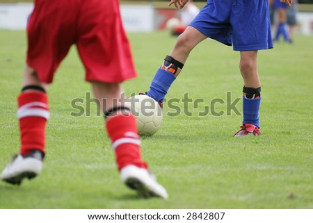 Boys playing soccer. Detail of a soccer match. - stock photo