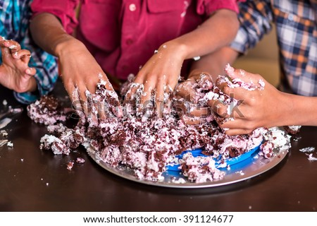 Boys smashing cake with hands. Three children's hands smash cake. This is the end. We've done everything we could. - stock photo