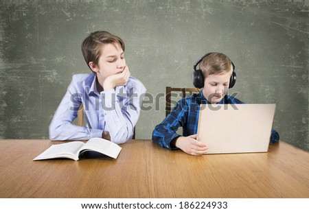 Boys with books and  laptop - stock photo