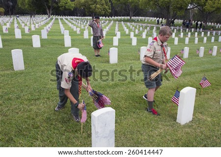 Boyscouts placing 85, 000 US Flags at Annual Memorial Day Event, Los Angeles National Cemetery, California, USA, 05.24.2014 - stock photo