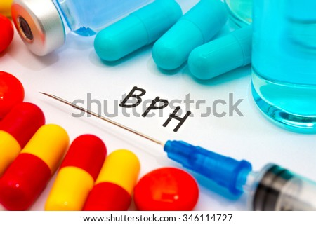 BPH - diagnosis written on a white piece of paper. Syringe and vaccine with drugs. - stock photo