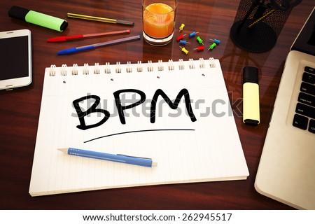 BPM - Business Process Management - handwritten text in a notebook on a desk - 3d render illustration. - stock photo