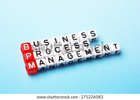 bpm  business process management on  dices  on blue background - stock photo