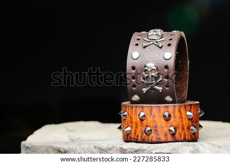 bracelets with spikes and skulls  - stock photo