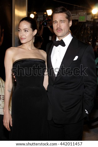 Brad Pitt and Angelina Jolie at the Los Angeles premiere of 'The Curious Case of Benjamin Button' held at the Mann Village Theater in Westwood, USA on December 8, 2008. - stock photo