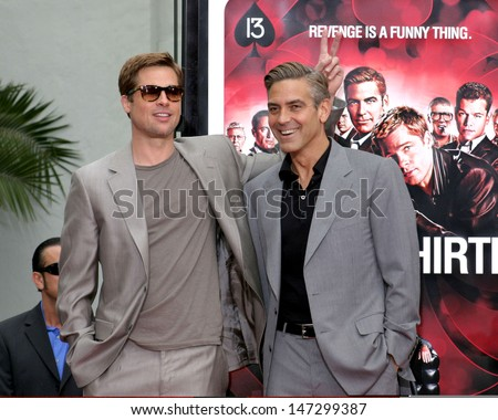 Brad Pitt and George Clooney at the Handprint & Footprint Ceremony For Ocean's Thirteen's George Clooney, Brad Pitt, Matt Damon, and Jerry Weintraub Gruman's Chinese Theater Los Angeles, CA June 5, 2007 - stock photo
