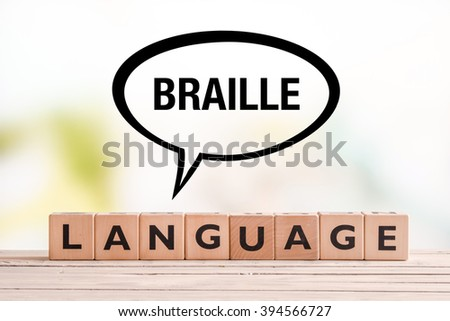 Braille language lesson sign made of cubes on a table - stock photo