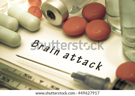 Brain attack - diagnosis written on a white piece of paper. Syringe and vaccine with drugs. Selective focus - stock photo