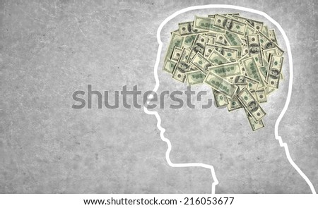 Brain currency / outline of a man's head with the brain in the shape of money  - stock photo