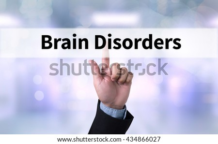 Brain Disorders  Business man with hand pressing a button on blurred abstract background - stock photo