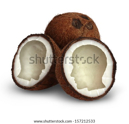 Brain food and natural therapy with a healthy eating diet concept as an opened organic coconut seed in the shape of a human head as a symbol for foods containing essential vitamins for good health. - stock photo