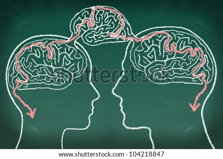 Brain Maze Puzzle in The Human Heads, drawing on the chalkboard, Thinking Communication Concept - stock photo