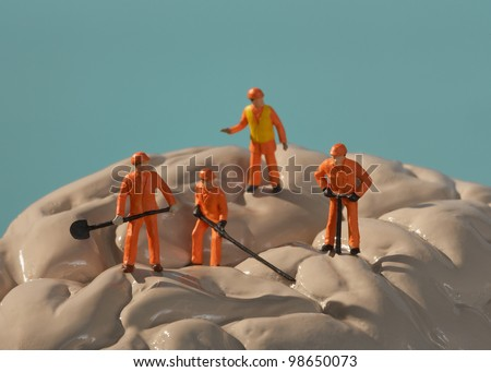 Brain surgery men at work - stock photo