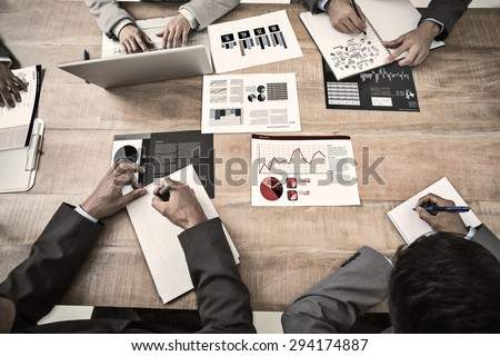 Brainstorm against business interface with graphs and data - stock photo