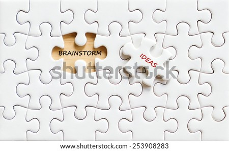Brainstorm and ideas words on jigsaw puzzle background, business concept - stock photo
