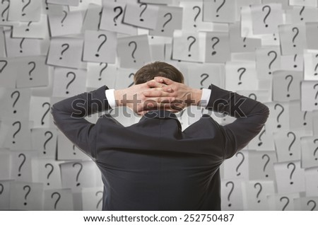 Brainstorming. Businessman solves complex problem - stock photo