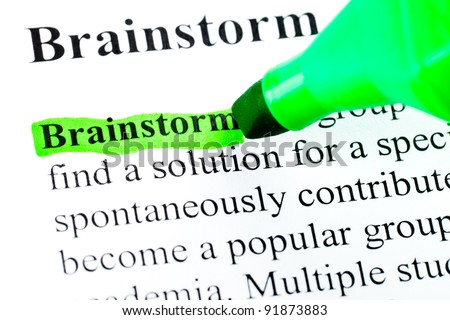 Brainstorming  definition highlighted by green marker on white - stock photo