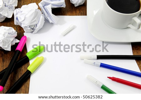 brainstorming: desk with blank paper, paperballs, pens and coffee waiting for creative ideas - stock photo
