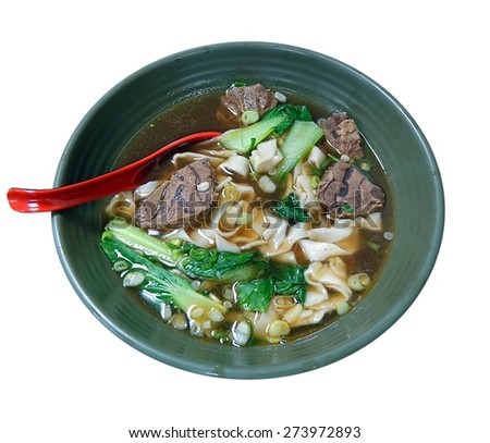Braised beef in broth with noodles and chives is a traditional dish in Taiwan - stock photo