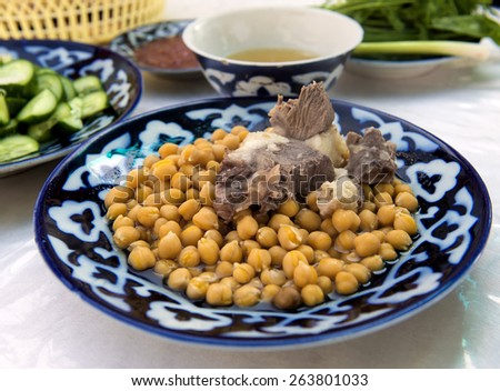 Braised lamb with peas - a traditional Uzbek dish. - stock photo