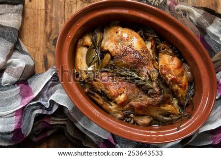 Braised rabbit with rosemary, garlic and juniper berries - stock photo