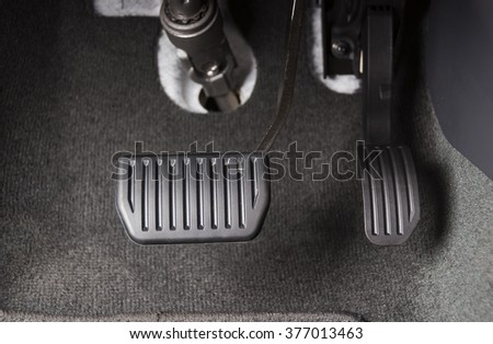 Brake and accelerator pedal of automatic transmission car in black interior - stock photo