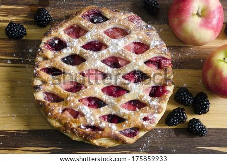 Bramley apple and blackberry pie - stock photo