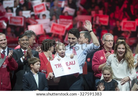 BRAMPTON - OCTOBER 4 : Justin Trudeau along with his entire family waiving towards their supporters during an election rally of the Liberal Party of Canada on October 4, 2015 in Brampton, Canada. - stock photo