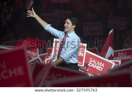 BRAMPTON - OCTOBER 4 : Justin Trudeau cheering his supporters during an election rally of the Liberal Party of Canada on October 4, 2015 in Brampton, Canada. - stock photo