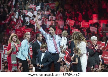 BRAMPTON - OCTOBER 4 :Justin Trudeau waiving hands towards his party followers during an election rally of the Liberal Party of Canada on October 4, 2015 in Brampton, Canada. - stock photo