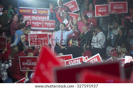 BRAMPTON - OCTOBER 4 :Justin Trudeau while being surrounded by his supporters during an election rally of the Liberal Party of Canada on October 4, 2015 in Brampton, Canada. - stock photo