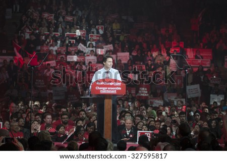 BRAMPTON - OCTOBER 4 :People listening to Justin Trudeau  during an election rally of the Liberal Party of Canada on October 4, 2015 in Brampton, Canada. - stock photo