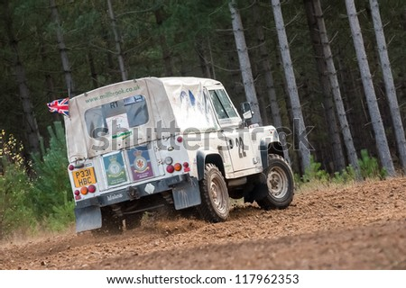 BRAMSHILL FOREST, UK - NOVEMBER 3, 2012: RAF military team driver Steve Partridge in a Land Rover Wolf on the Warren stage of the MSA Tempest Rally in Bramshill Forest, UK on November 3, 2012 - stock photo