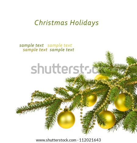 branch of a Christmas tree with gold balls and gold garland, isolated on white background - stock photo