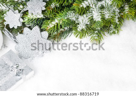 branch of Christmas tree with gift box and star - stock photo