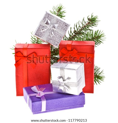 branch of Christmas tree with gift boxes  isolated on white background Christmas concept - stock photo